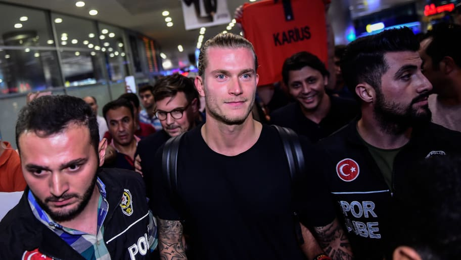 German goalkeeper Loris Karius (C) reacts  on August 25, 2018, as he arrives at the Ataturk International Airport in Istanbul to play with Besiktas on loan from Liverpool. - Liverpool goalkeeper Loris Karius has joined Turkish side Besiktas on a two-year loan deal, the Premier League club announced on August 25, 2018. (Photo by Yasin AKGUL / AFP)        (Photo credit should read YASIN AKGUL/AFP/Getty Images)