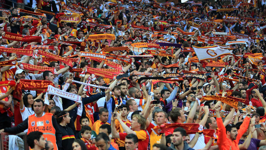 Galatasaray fans hold scarfs as they support their team during the Turkish super league football match between Galatasay and Sivasspor on May 5, 2013 at Turk Telekom Arena, in Istanbul.  AFP PHOTO/MIRA        (Photo credit should read MIRA/AFP/Getty Images)