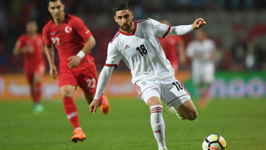 Iran's Alireza Jahanbakhsh (R) vies with Turley's Kaan Ayhan on May 28, 2018 during the International friendly football match between Turkey and Iran at Basaksehir Fatih Terim stadium in Istanbul. (Photo by OZAN KOSE / AFP)        (Photo credit should read OZAN KOSE/AFP/Getty Images)