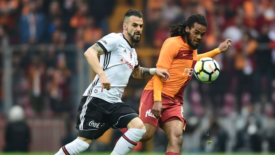 Galatasaray's Belgian defender Jason Denayer (R) vies for the ball with Besiktas' Spanish forward Alvaro Negredo during the Turkish Spor Toto Super league football match between Galataray and Besiktas on April 29, 2018 at the TT Arena stadium in Istanbul. (Photo by OZAN KOSE / AFP)        (Photo credit should read OZAN KOSE/AFP/Getty Images)