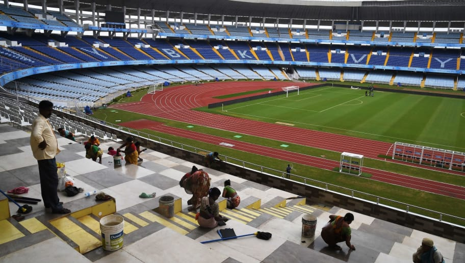 Indian labourers work at Salt Lake Stadium, officially known as Vivekananda Yuba Bharati Krirangan (VYBK), ahead of the FIFA U-17 World Cup in Kolkata on October 7, 2017. / AFP PHOTO / Dibyangshu SARKAR        (Photo credit should read DIBYANGSHU SARKAR/AFP/Getty Images)