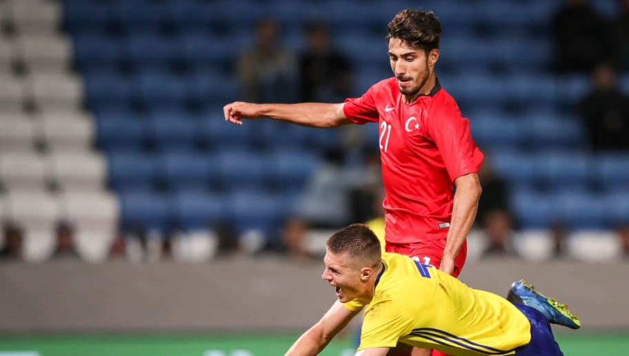 Turkey's Atakan Cankaya (R) fouls Sweden's Mattias Svanberg as Turkey's Berkay Ozcan looks on during the UEFA U-21 Qualifying group 6 match between Sweden and Turkey in Helsingborg, Sweden, on September 11, 2018 (Photo by Andreas HILLERGREN / TT News Agency / AFP) / Sweden OUT        (Photo credit should read ANDREAS HILLERGREN/AFP/Getty Images)