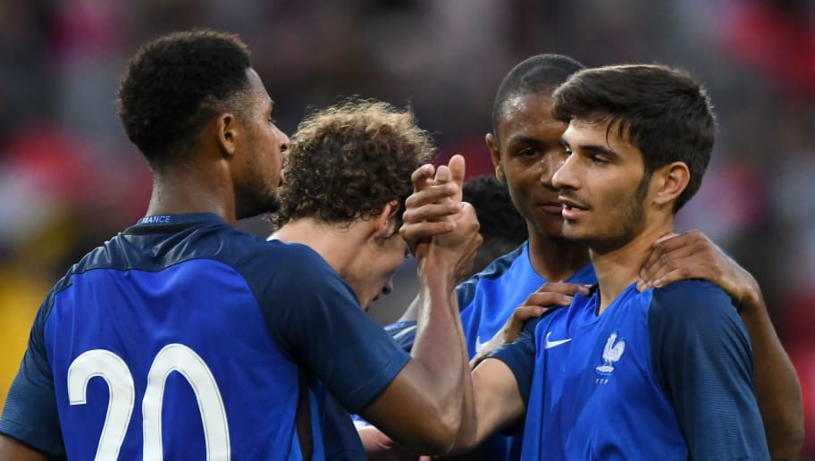 France's Martin Terrier (R) is congratulated by France's forward Lys Mousset (L) and France's defender Abdou Diallo (2rd R) on scoring during the qualifying Euro 2017 U-21 football match between France and Kazakhstan at The MMArena Stadium, in Le Mans, north-western France, on September 5, 2017. / AFP PHOTO / JEAN-FRANCOIS MONIER        (Photo credit should read JEAN-FRANCOIS MONIER/AFP/Getty Images)