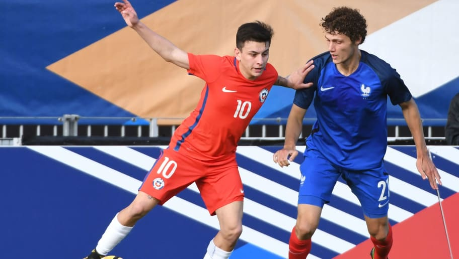 Chile's forward Pablo Mauricio Aranguiz Salazar (L) vies for the ball with France's defender Benjamin Pavard during the friendly under-21 football match between France and Chile at Francis Le Basser Stadium in Laval on September 1, 2017. / AFP PHOTO / JEAN-FRANCOIS MONIER        (Photo credit should read JEAN-FRANCOIS MONIER/AFP/Getty Images)