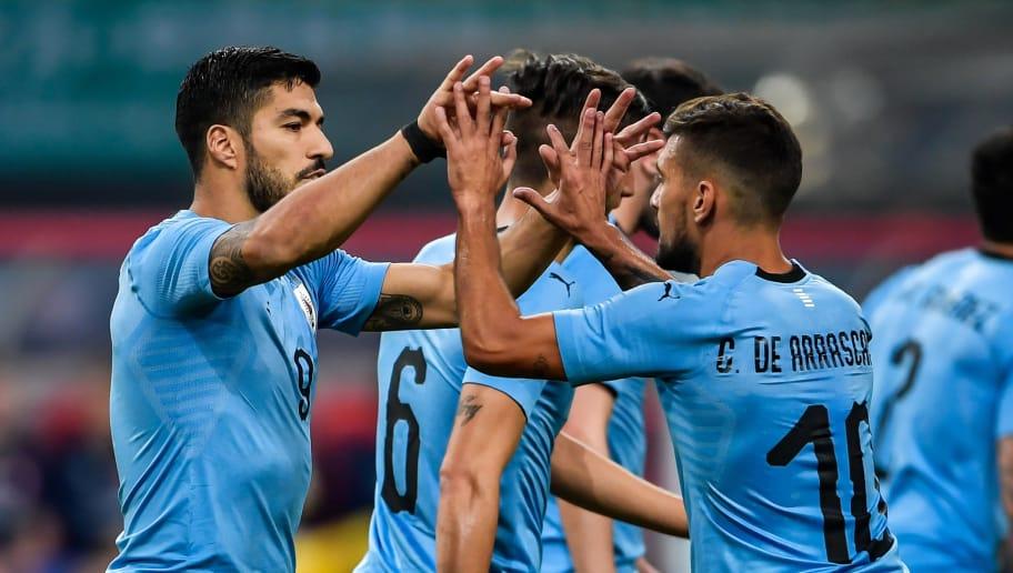 a15947cd0ec Luis Suarez (L) of Uruguay celebrates with teammate Giorian De Arrascaeta  (R