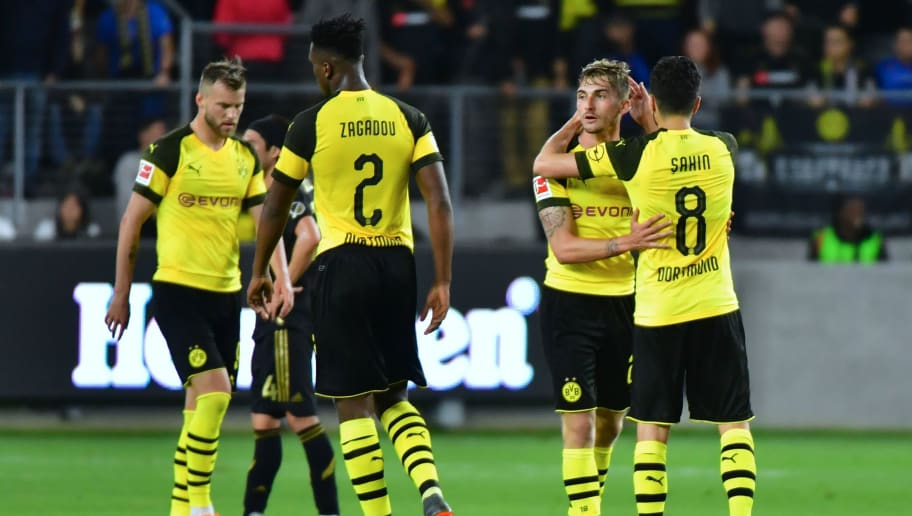 Maximilian Philipp (2/R) of Borussia Dortmund celebrates with teammate Nuri Sahin (#8) after scoring the equalizer against LAFC (Los ANgeles Football Club) during their international soccer friendly in Los Angeles, California on May 22, 2018. - The game ended in a 1-1 draw. (Photo by Frederic J. BROWN / AFP)        (Photo credit should read FREDERIC J. BROWN/AFP/Getty Images)