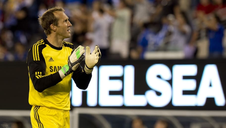 Chelsea's goalkeeper Mark Schwarzer applauds after his team's second goal during a 2013 International Champions Cup match against AC Milan on August 4 , 2013 at MetLife stadium in East Rutherford, New Jersey.     AFP PHOTO/Don Emmert        (Photo credit should read DON EMMERT/AFP/Getty Images)