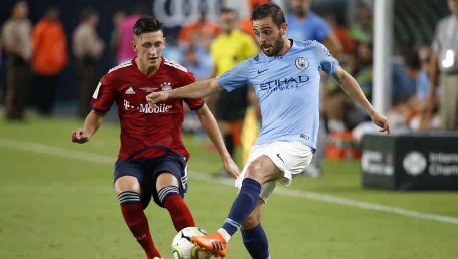 Manchester City's Portuguese midfielder Bernardo Silva (R) vies for the ball with Bayern Munich's German defense Jonathan Meier during the International Champions Cup friendly match between FC Bayern Munich and Manchester City at Hard Rock Stadium in Miami, Florida, on July 28, 2018. (Photo by RHONA WISE / AFP)        (Photo credit should read RHONA WISE/AFP/Getty Images)