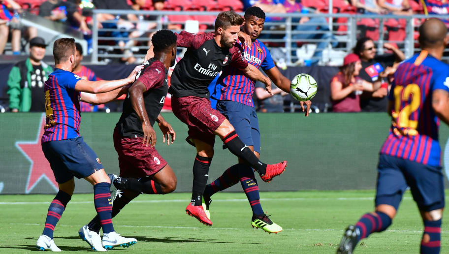 Fabio Borini of AC Milan (C) vies for the ball with Marlon Santos of Barcelona during the International Champions Cup (ICC) friendly football match between Barcelona and AC Milan in Santa Clara, California, on August 4, 2018. (Photo by Frederic J. BROWN / AFP)        (Photo credit should read FREDERIC J. BROWN/AFP/Getty Images)