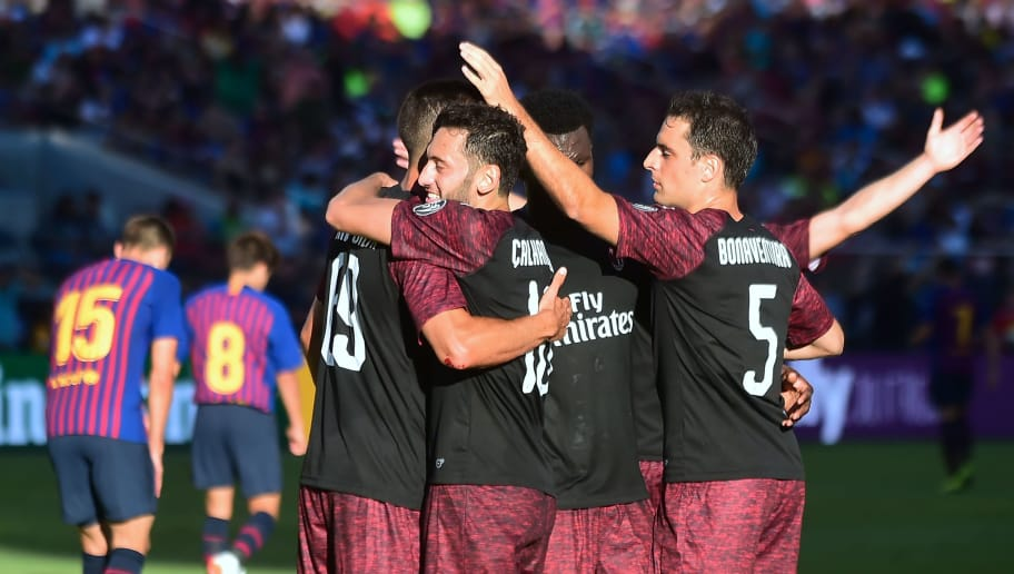 Andre Silva (L) of AC Milan celebrates with teammates including Hakan Calhanoglu (C) and Giacomo Bonaventura after scoring an injury time winner during the International Champions Cup (ICC) friendly football match between Barcelona and AC Milan in Santa Clara, California, on August 4, 2018. (Photo by Frederic J. BROWN / AFP)        (Photo credit should read FREDERIC J. BROWN/AFP/Getty Images)