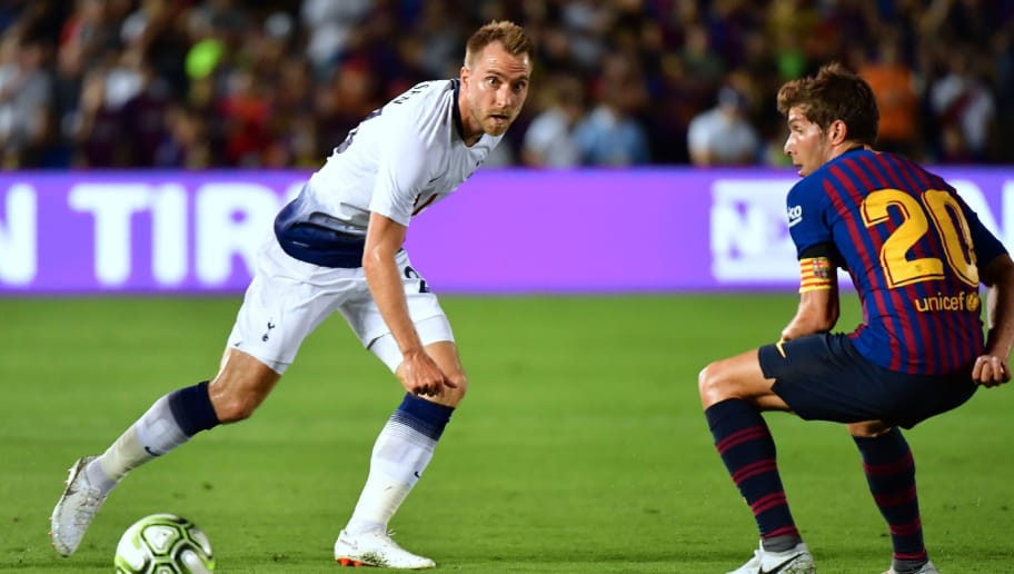Christian Eriksen of Tottenham Hotspur passes under pressure from Sergi Roberto of Barcelona (R) during the International Champions Cup football match between Barcelona and Tottenham Hotspur on July 28, 2018 in Pasadena, California. (Photo by Frederic J. BROWN / AFP)        (Photo credit should read FREDERIC J. BROWN/AFP/Getty Images)