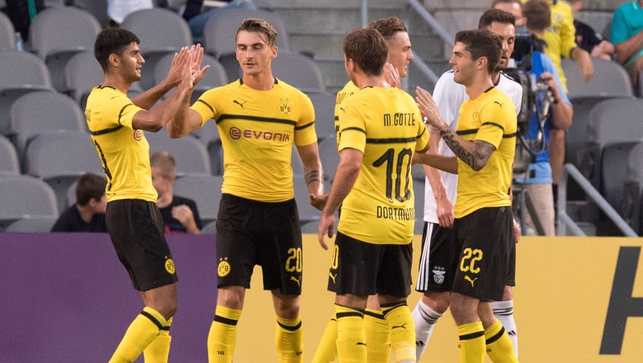 Borussia Dortmund's Maximilian Philipp (2nd L) celebrates with teammates after scoring his second goal against Benfica during the 2018 International Champions Cup at Heinz Field in Pittsburgh, PA, on July 25, 2018. (Photo by JIM WATSON / AFP)        (Photo credit should read JIM WATSON/AFP/Getty Images)