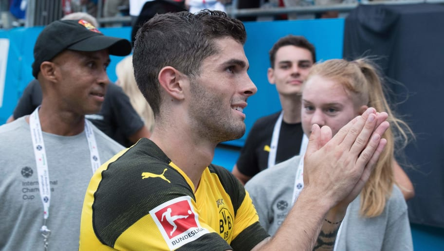 Borussia Dortmund's Christian Pulisic (C) heads to the locker room after defeating Liverpool 3-1 in their 2018 International Champions Cup match at Bank of America Stadium in Charlotte, North Carolina, on July 22, 2018. (Photo by JIM WATSON / AFP)        (Photo credit should read JIM WATSON/AFP/Getty Images)