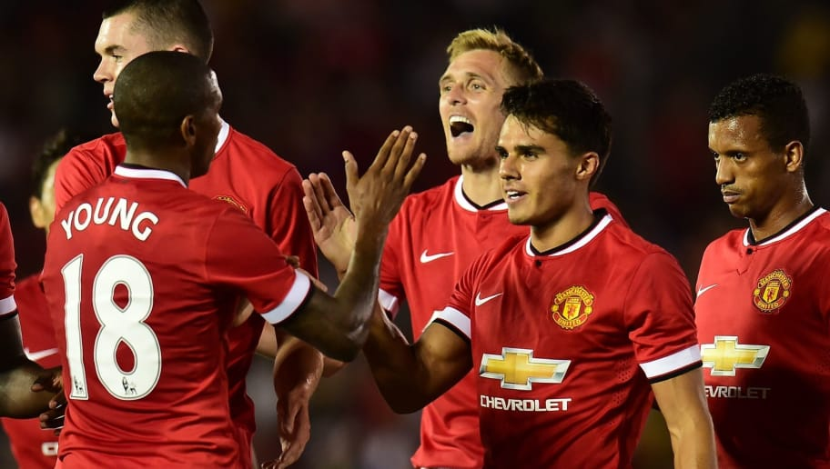CORRECTION-ID Manchester United players celebrate as goalscorer Reece James (R) is approached for congratulations by Ashley Young during their Chevrolet Cup match at the Rose Bowl in Pasadena, California on July 23, 2014, where Manchester United defeated the LA Galaxy 7-0. AFP PHOTO/Frederic J. Brown (Photo by Frederic J. BROWN / AFP) (Photo credit should read FREDERIC J. BROWN/AFP/Getty Images)