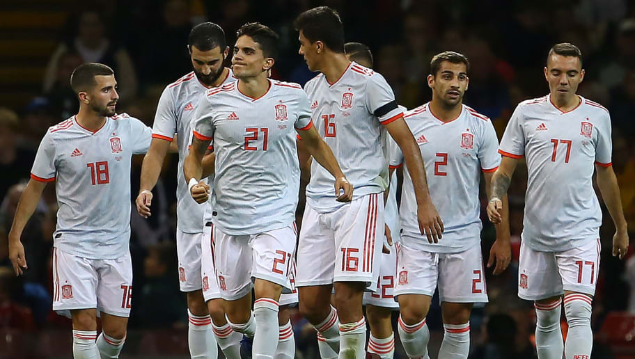 Spain's defender Marc Bartra (3L) celebrates scoring his team's fourth goal during the international friendly football match between Wales and Spain at The Principality Stadium in Cardiff, south Wales, on October 11, 2018. (Photo by GEOFF CADDICK / AFP)        (Photo credit should read GEOFF CADDICK/AFP/Getty Images)