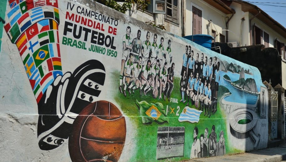 View of a mural paint depicting the final match of the 1950 FIFA World Cup, Brazil vs Uruguay, in Rio de Janeiro on April 08, 2014, Brazil. Uruguay won the final 2-1.   AFP PHOTO / CHRISTOPHE SIMON        (Photo credit should read CHRISTOPHE SIMON/AFP/Getty Images)