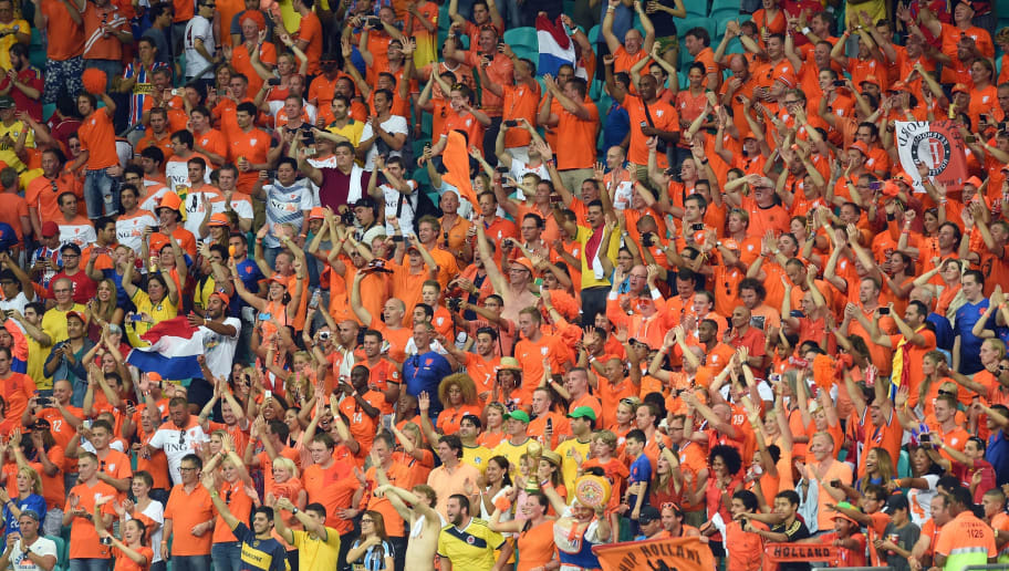 Netherlands' supporters cheer during a Group B football match between Spain and the Netherlands at the Fonte Nova Arena in Salvador during the 2014 FIFA World Cup on June 13, 2014.    AFP PHOTO / EMMANUEL DUNAND        (Photo credit should read EMMANUEL DUNAND/AFP/Getty Images)