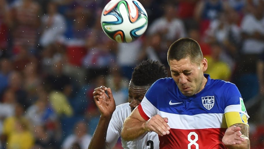 US forward Clint Dempsey (R) and Ghana's forward Asamoah Gyan (L) jump for the ball during a Group G football match between Ghana and US at the Dunas Arena in Natal during the 2014 FIFA World Cup on June 16, 2014.  AFP PHOTO / EMMANUEL DUNAND        (Photo credit should read EMMANUEL DUNAND/AFP/Getty Images)