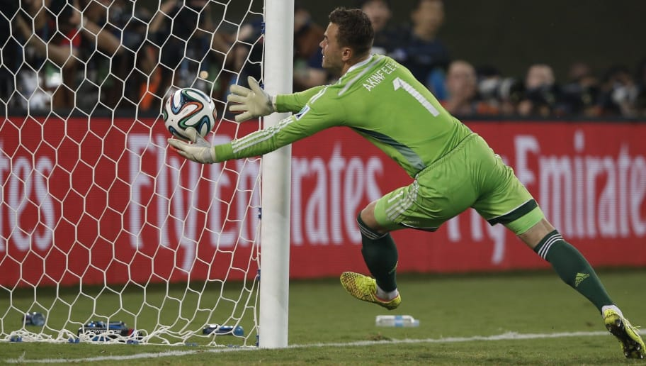 Russia's goalkeeper Igor Akinfeev fails to save the 0-1 goal during the Group H football match between Russia and South Korea in the Pantanal Arena in Cuiaba during the 2014 FIFA World Cup on June 17, 2014. AFP PHOTO / ADRIAN DENNIS        (Photo credit should read ADRIAN DENNIS/AFP/Getty Images)