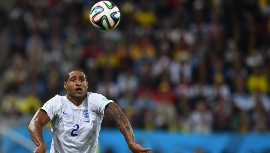 England's defender Glen Johnson throws the ball in during the Group D football match between Uruguay and England at the Corinthians Arena in Sao Paulo on June 19, 2014, during the 2014 FIFA World Cup. AFP PHOTO / BEN STANSALL        (Photo credit should read BEN STANSALL/AFP/Getty Images)