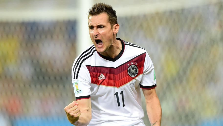Germany's forward Miroslav Klose celebrates after scoring during a Group G football match between Germany and Ghana at the Castelao Stadium in Fortaleza during the 2014 FIFA World Cup on June 21, 2014.           AFP PHOTO / JAVIER SORIANO        (Photo credit should read JAVIER SORIANO/AFP/Getty Images)