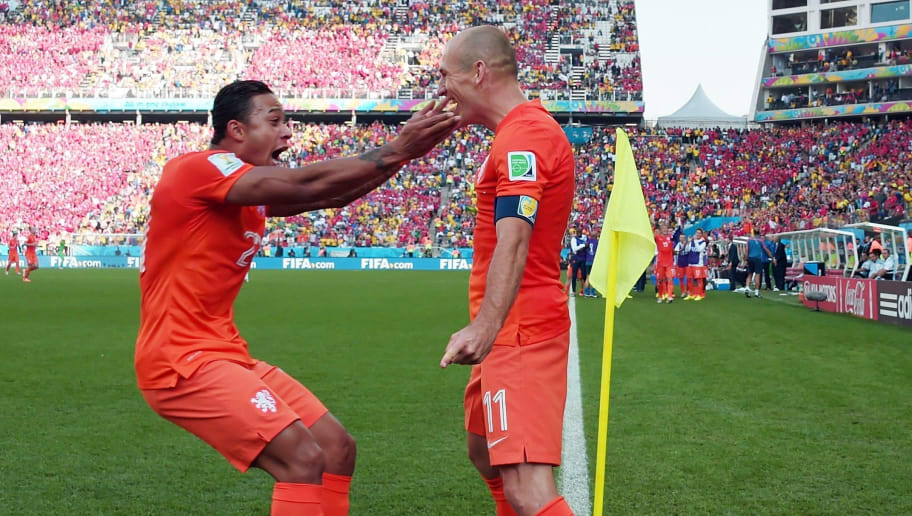 Netherlands' forward Memphis Depay (L) celebrates scoring with Netherlands' forward Arjen Robben during the Group B football match between Netherlands and Chile at the Corinthians Arena in Sao Paulo during the 2014 FIFA World Cup on June 23, 2014. AFP PHOTO / DAMIEN MEYER        (Photo credit should read DAMIEN MEYER/AFP/Getty Images)