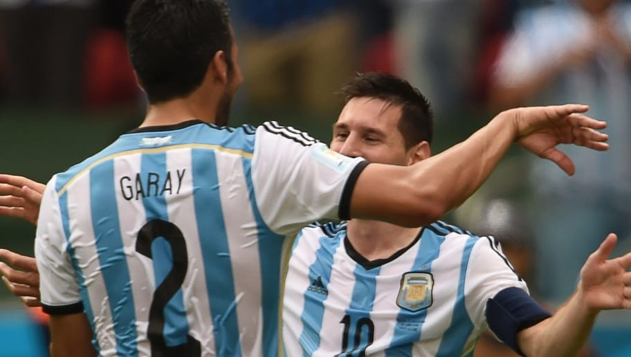 Argentina's forward Lionel Messi (R) celebrates his second goal with Argentina's defender Ezequiel Garay, during a Group F football match between Nigeria and Argentina at the Beira-Rio Stadium in Porto Alegre during the 2014 FIFA World Cup on June 25, 2014.    AFP PHOTO / PEDRO UGARTE        (Photo credit should read PEDRO UGARTE/AFP/Getty Images)