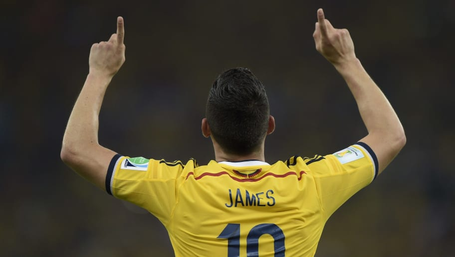 Colombia's midfielder James Rodriguez celebrates after scoring during the Round of 16 football match between Colombia and Uruguay at the Maracana Stadium in Rio de Janeiro during the 2014 FIFA World Cup on June 28, 2014.  AFP PHOTO / DANIEL GARCIA        (Photo credit should read DANIEL GARCIA/AFP/Getty Images)