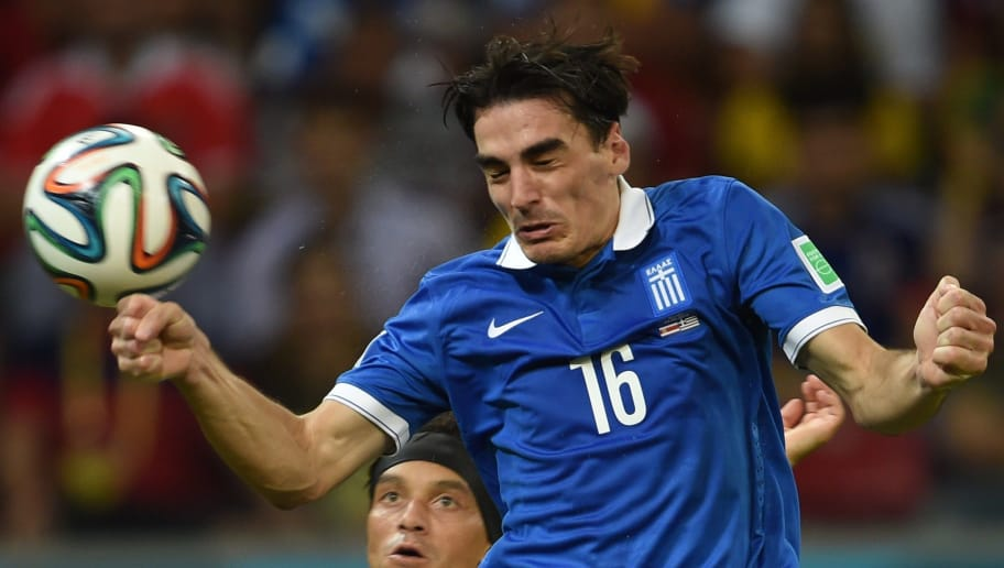 Greece's midfielder Lazaros Christodoulopoulos heads the ball during a Round of 16 football match between Costa Rica and Greece at Pernambuco Arena in Recife during the 2014 FIFA World Cup on June 29, 2014.            AFP PHOTO / PEDRO UGARTE        (Photo credit should read PEDRO UGARTE/AFP/Getty Images)