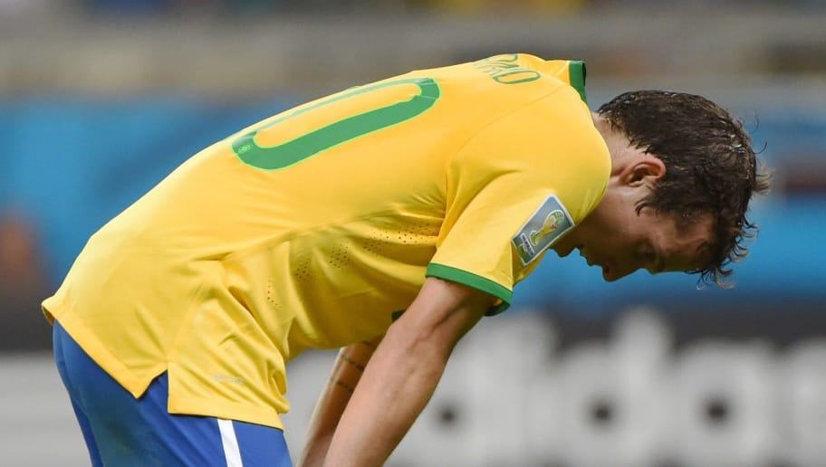Brazil's forward Bernard reacts after the semi-final football match between Brazil and Germany at The Mineirao Stadium in Belo Horizonte during the 2014 FIFA World Cup on July 8, 2014.   AFP PHOTO / PEDRO UGARTE        (Photo credit should read PEDRO UGARTE/AFP/Getty Images)