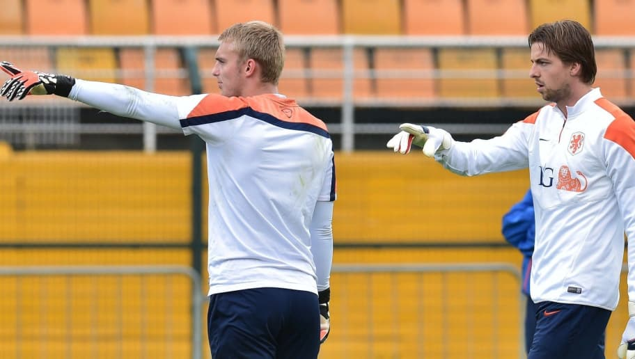 Netherlands' goalkeeper Jasper Cillessen (L) gestures with teammate Netherlands' goalkeeper Tim Krul on the training pitch at The Estádio Paulo Machado de Carvalho (Pacaembu) in Sao Paulo on July 10, 2014, ahead of their third place play-off against host nation Brazil in the 2014 FIFA World Cup.   Despite their World Cup semi-final elimination on penalties by Argentina, the Netherlands and their coach Louis van Gaal will move on from the tournament with their reputations unquestionably enhanced.  AFP PHOTO / NELSON ALMEIDA        (Photo credit should read NELSON ALMEIDA/AFP/Getty Images)