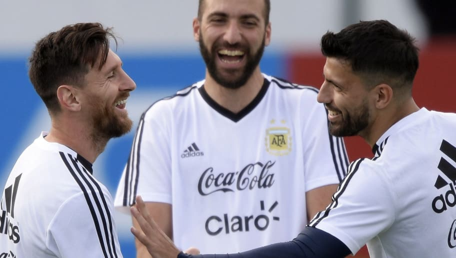 (From L) Argentina's forward Lionel Messi, forward Gonzalo Higuain and forward Sergio Aguero laugh during a training session of Argentina's national football team at the team's base camp in Bronnitsy, near Moscow, on June 11, 2018 ahead of the Russia 2018 World Cup football tournament. (Photo by JUAN MABROMATA / AFP)        (Photo credit should read JUAN MABROMATA/AFP/Getty Images)