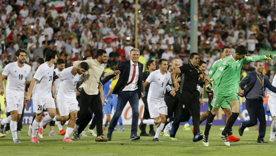 Portuguese coach Carlos Queiroz (C) of the Iranian national football team celebrates among players after winning the 2018 World Cup qualifying football match between Iran and Uzbekistan at the Azadi Stadium in Tehran on June 12, 2017. Iran won 2-0. / AFP PHOTO / ATTA KENARE        (Photo credit should read ATTA KENARE/AFP/Getty Images)