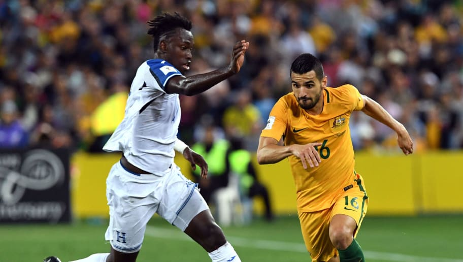 Australia's Aziz Behich (R) is tackled by Honduras' Albert Elis during their 2018 World Cup qualification play-off football match against at Stadium Australia in Sydney on November 15, 2017. / AFP PHOTO / William WEST / -- IMAGE RESTRICTED TO EDITORIAL USE - STRICTLY NO COMMERCIAL USE --        (Photo credit should read WILLIAM WEST/AFP/Getty Images)
