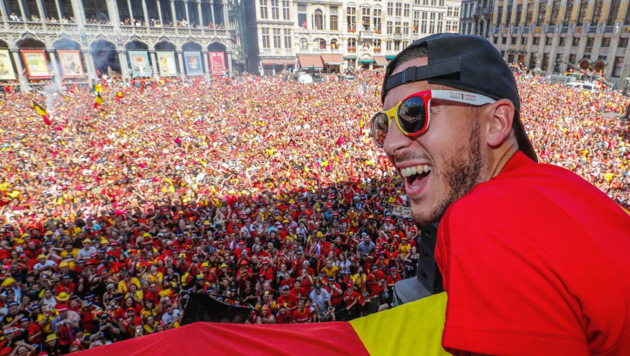 Belgium's captain Eden Hazard celebrates at the Grand Place/Grote Markt in Brussels city center, as Belgian national football team Red Devils arrive to celebrate with supporters at the balcony of the city hall after reaching the semi-finals and winning the bronze medal at the Russia 2018 World Cup on July 15, 2018. (Photo by Yves HERMAN / BELGA / AFP) / Belgium OUT        (Photo credit should read YVES HERMAN/AFP/Getty Images)