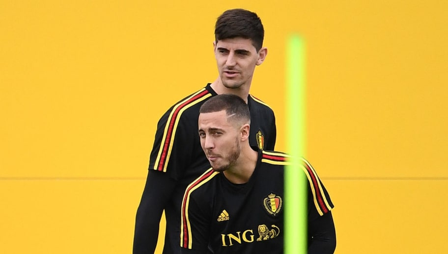 Belgium's goalkeeper Thibaut Courtois (back) and Belgium's forward Eden Hazard attend a training session at the Guchkovo Stadium in Dedovsk, outside Moscow, on July 9, 2018, on the eve of their Russia 2018 World Cup semi-final football match against France. (Photo by FRANCK FIFE / AFP)        (Photo credit should read FRANCK FIFE/AFP/Getty Images)