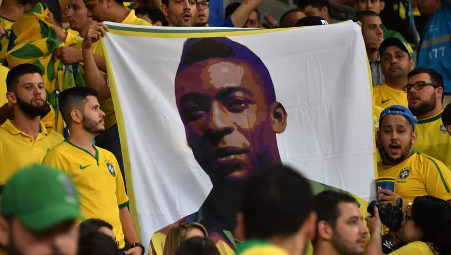 Supporters of Brazil display a banner with an image of Brazilian football legend Pele as they wait for the start of the 2018 World Cup qualifier football match against Chile, in Sao Paulo, Brazil, on October 10, 2017. / AFP PHOTO / Nelson ALMEIDA        (Photo credit should read NELSON ALMEIDA/AFP/Getty Images)