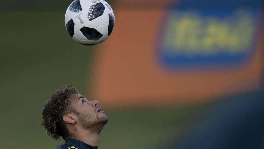 Brazil's Neymar attends a training session of the national football team ahead of FIFA's 2018 World Cup, at Granja Comary training centre in Teresopolis, Rio de Janeiro, Brazil, on May 22, 2018. (Photo by Mauro PIMENTEL / AFP)        (Photo credit should read MAURO PIMENTEL/AFP/Getty Images)