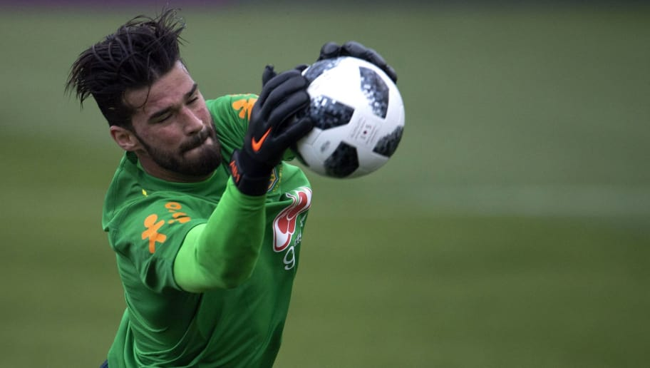 Brazil's goalkeeper Alisson attends a training session of the national football team ahead of FIFA's 2018 World Cup, at Granja Comary training centre in Teresopolis, Rio de Janeiro, Brazil, on May 24, 2018. (Photo by MAURO PIMENTEL / AFP)        (Photo credit should read MAURO PIMENTEL/AFP/Getty Images)