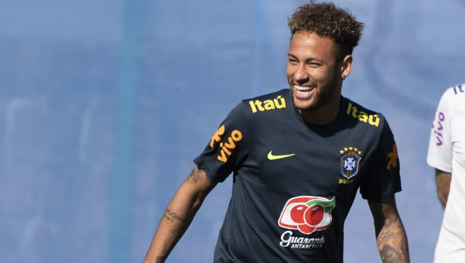 Brazil's striker Neymar reacts as he takes part in a training session of the Brazilian national football team at the Yug Sports stadium in Sochi, on June 13, 2018 ahead of the Russia 2018 World Cup football tournament. (Photo by Jewel SAMAD / AFP)        (Photo credit should read JEWEL SAMAD/AFP/Getty Images)