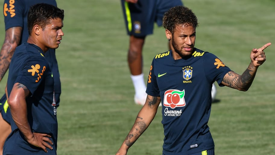 Brazil's defender Thiago Silva (L) and Brazil's forward Neymar (R) speak together as they take part in a training session of Brazil national football team at Yug Sport Stadium, in Sochi, on June 14, 2018, ahead of the Russia 2018 World Cup football tournament. (Photo by NELSON ALMEIDA / AFP)        (Photo credit should read NELSON ALMEIDA/AFP/Getty Images)