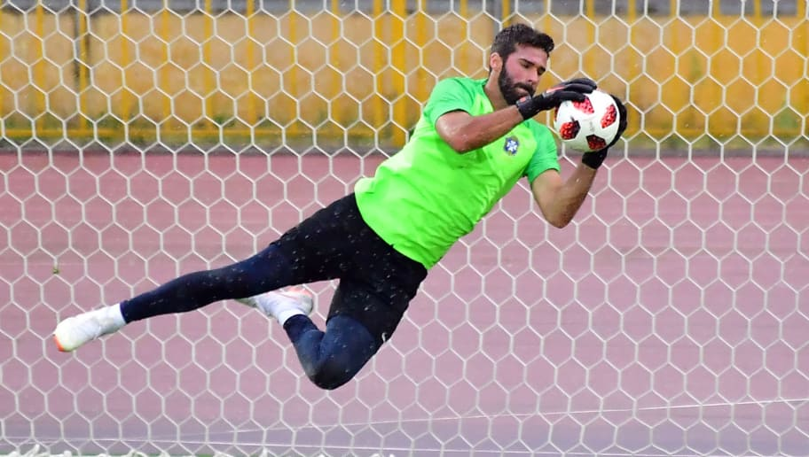 Brazil's goalkeeper Alisson attends a training session at the Tsentralny Stadium in Kazan on July 5, 2018, on the eve of the Russia 2018 World Cup quarter final football match between Belgium and Brazil. (Photo by Luis Acosta / AFP)        (Photo credit should read LUIS ACOSTA/AFP/Getty Images)