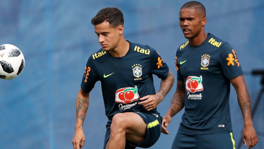 Brazil's forward Philippe Coutinho (L) and Brazil's forward Douglas Costa (R) take part in a training session of Brazil national football team at Yug Sport Stadium, in Sochi, on June 19, 2018, ahead of the Russia 2018 World Cup football tournament. (Photo by Adrian DENNIS / AFP)        (Photo credit should read ADRIAN DENNIS/AFP/Getty Images)
