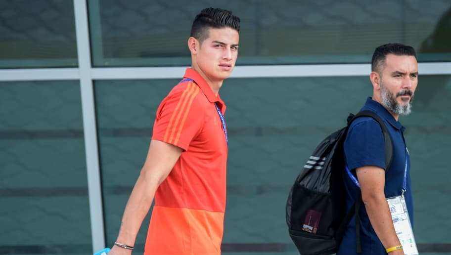 Colombia's midfielder James Rodriguez (L) walks after arriving at Kazan International Airport on July 1, 2018, as they travel to Moscow for their Russia 2018 World Cup round of 16 football match against England. (Photo by LUIS ACOSTA / AFP)        (Photo credit should read LUIS ACOSTA/AFP/Getty Images)