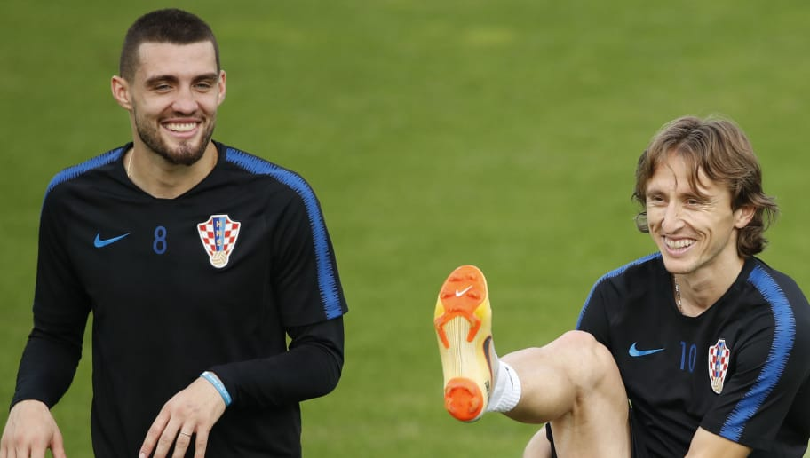 Croatia's midfielder Luka Modric (R) and Croatia's midfielder Mateo Kovacic attend a training session at the Luzhniki trining field in Moscow on July 14, 2018 on the eve of the Russia 2018 World Cup final football match between France and Croatia. (Photo by Odd ANDERSEN / AFP)        (Photo credit should read ODD ANDERSEN/AFP/Getty Images)