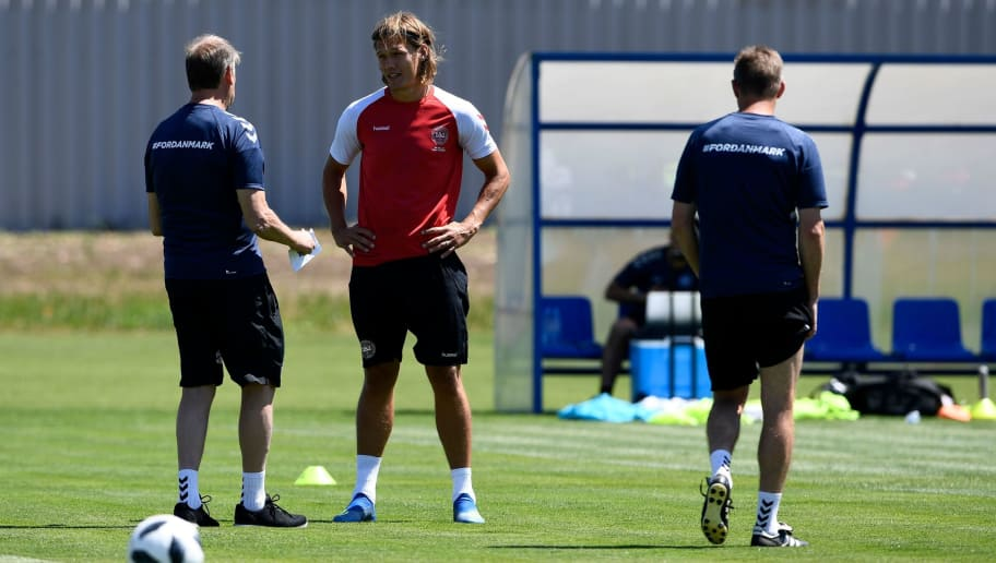 Denmark's defender Jannik Vestergaard (C) speaks with head coach Age Hareide (L) during a training session on June 12, 2018, in Vityazevo ahead of the Russia 2018 World Cup football tournament. (Photo by Jonathan NACKSTRAND / AFP)        (Photo credit should read JONATHAN NACKSTRAND/AFP/Getty Images)
