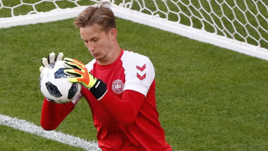 Denmark's goalkeeper Frederik Ronnow catches the ball as he takes part in a training session of Denmark's national football team at the Mordovia Arena in Saransk, on June 15, 2018 on the eve of their Groupe C Russia World Cup 2018 football match against Peru. (Photo by Jack GUEZ / AFP)        (Photo credit should read JACK GUEZ/AFP/Getty Images)
