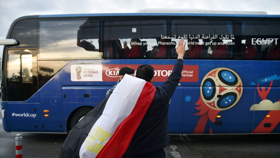 An Egypt fan waves at the bus of Egypt national football team upon its arrival at the Ekaterinburg airport, on June 13, 2018 ahead of the Russia 2018 World Cup football tournament. (Photo by HECTOR RETAMAL / AFP)        (Photo credit should read HECTOR RETAMAL/AFP/Getty Images)