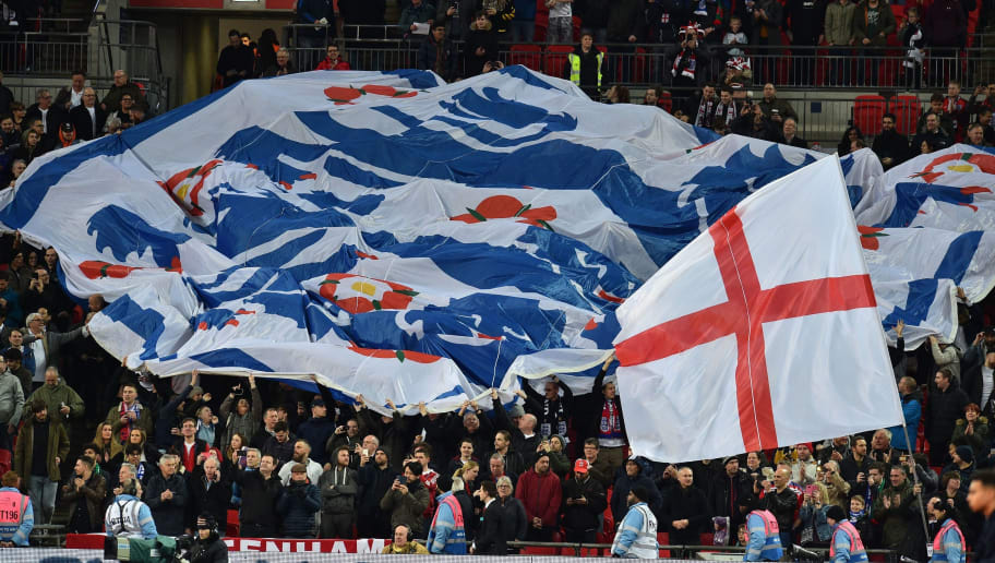 England supporters unveil a huge three lions flag in the crowd ahead of the International friendly football match between England and Italy at Wembley stadium in London on March 27, 2018. / AFP PHOTO / Glyn KIRK        (Photo credit should read GLYN KIRK/AFP/Getty Images)