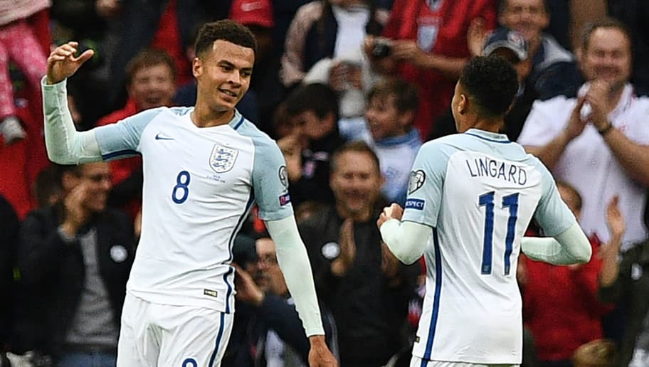 England's midfielder Dele Alli (L) celebrates with England's midfielder Jesse Lingard after scoring their second goal during the World Cup 2018 football qualification match between England and Malta at Wembley Stadium in London on October 8, 2016.  / AFP / Justin TALLIS / NOT FOR MARKETING OR ADVERTISING USE / RESTRICTED TO EDITORIAL USE        (Photo credit should read JUSTIN TALLIS/AFP/Getty Images)